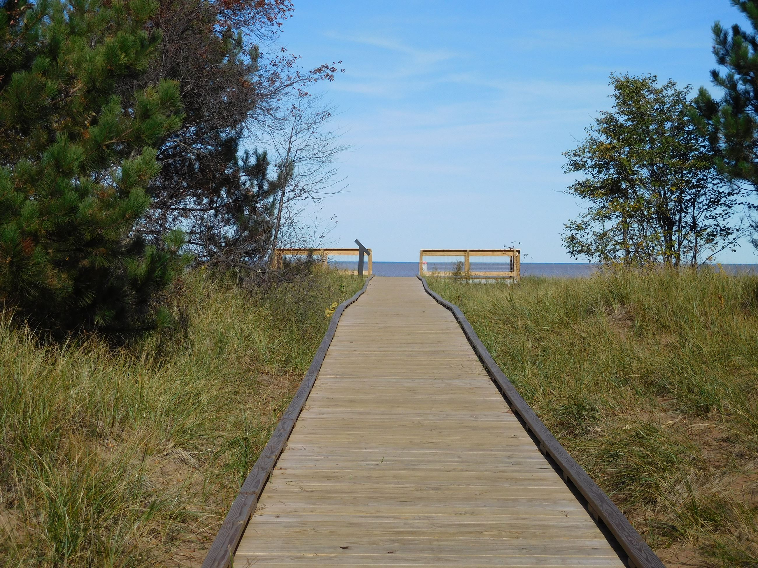 board walk leading up to viewing deck with Lake Superior on the horizon.