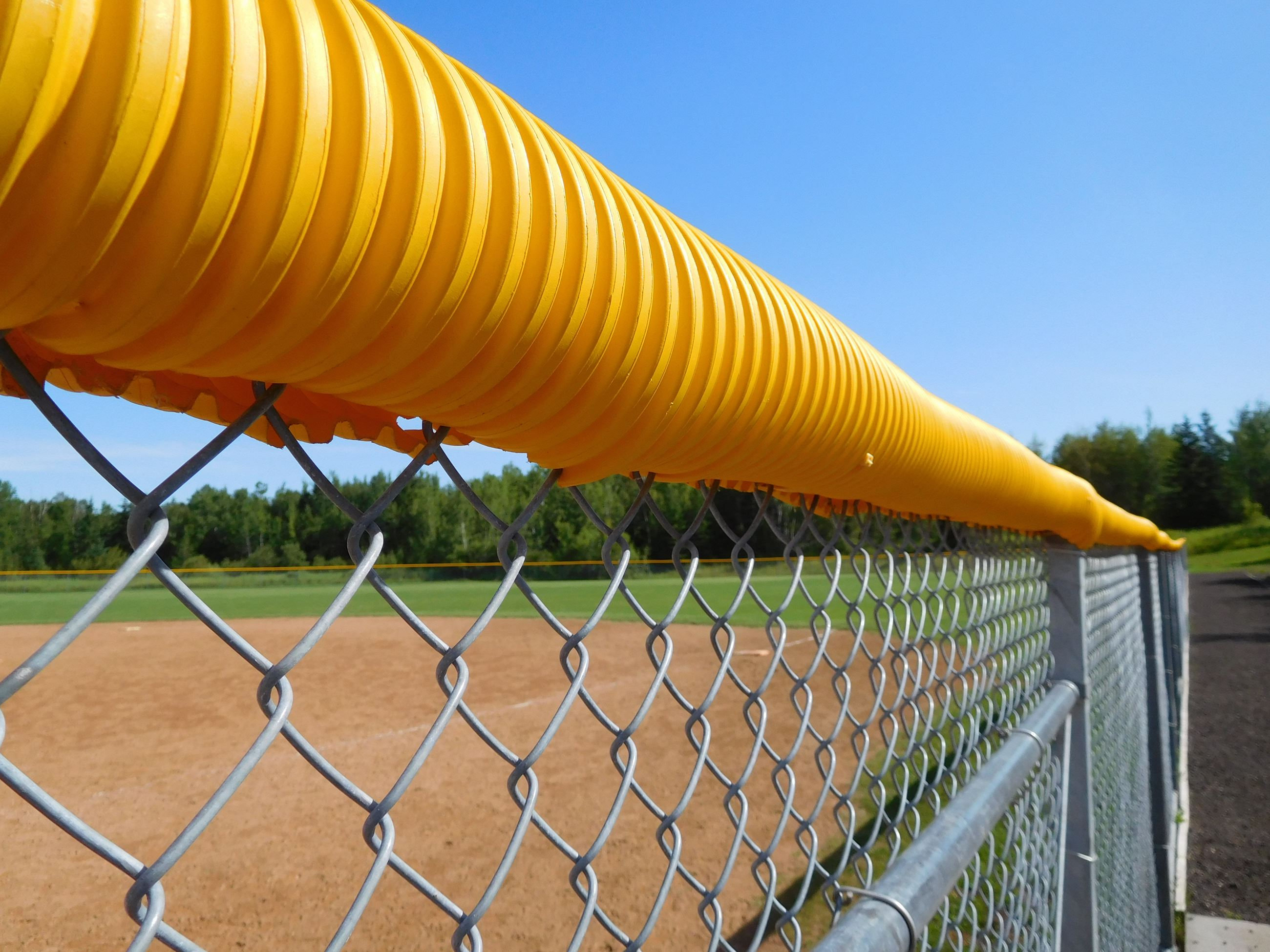 Itasca Memorial Ballfield fence with yellow cap