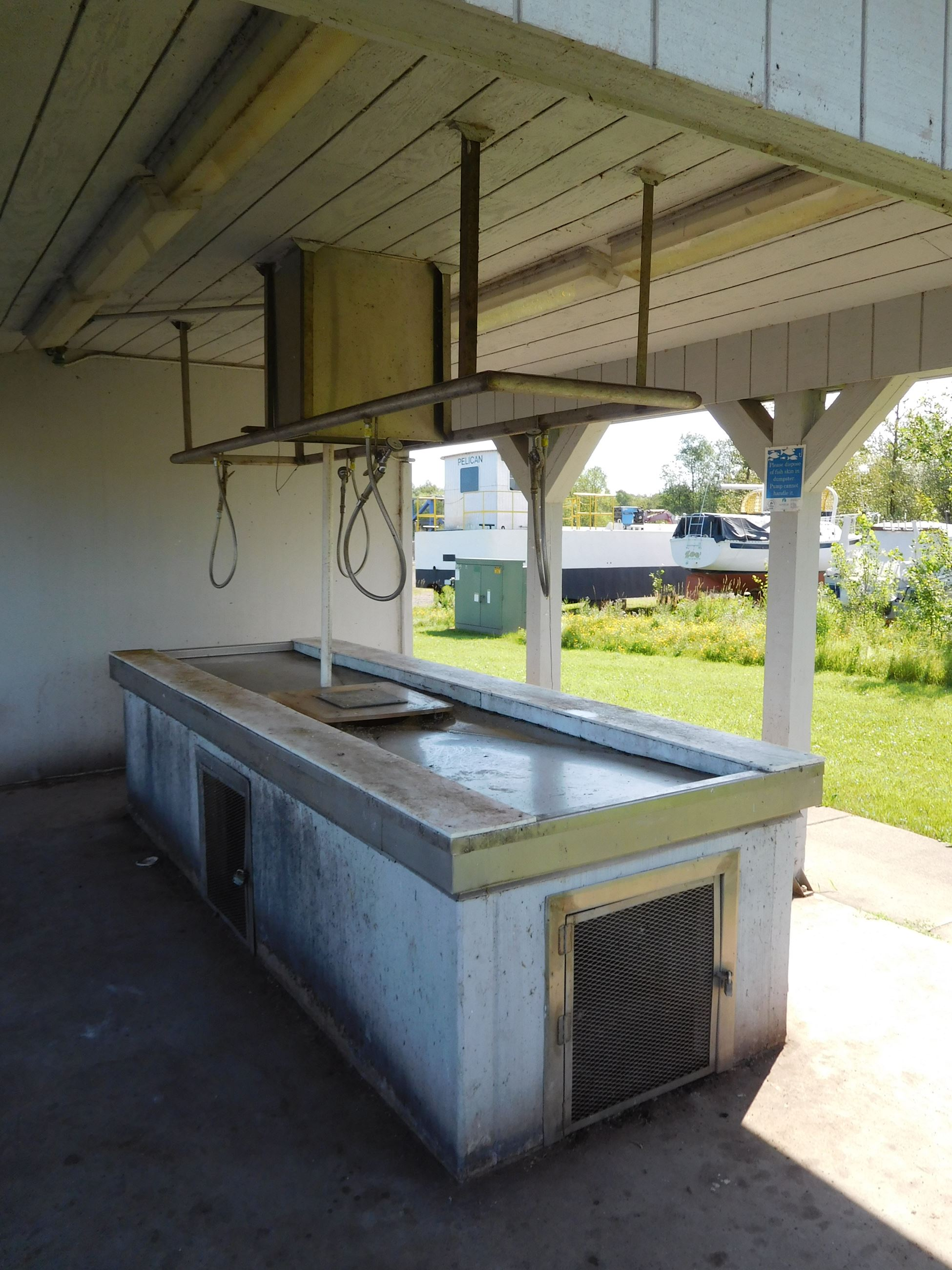 Loon's Foot fishing cleaning station with hoses and cleaning area