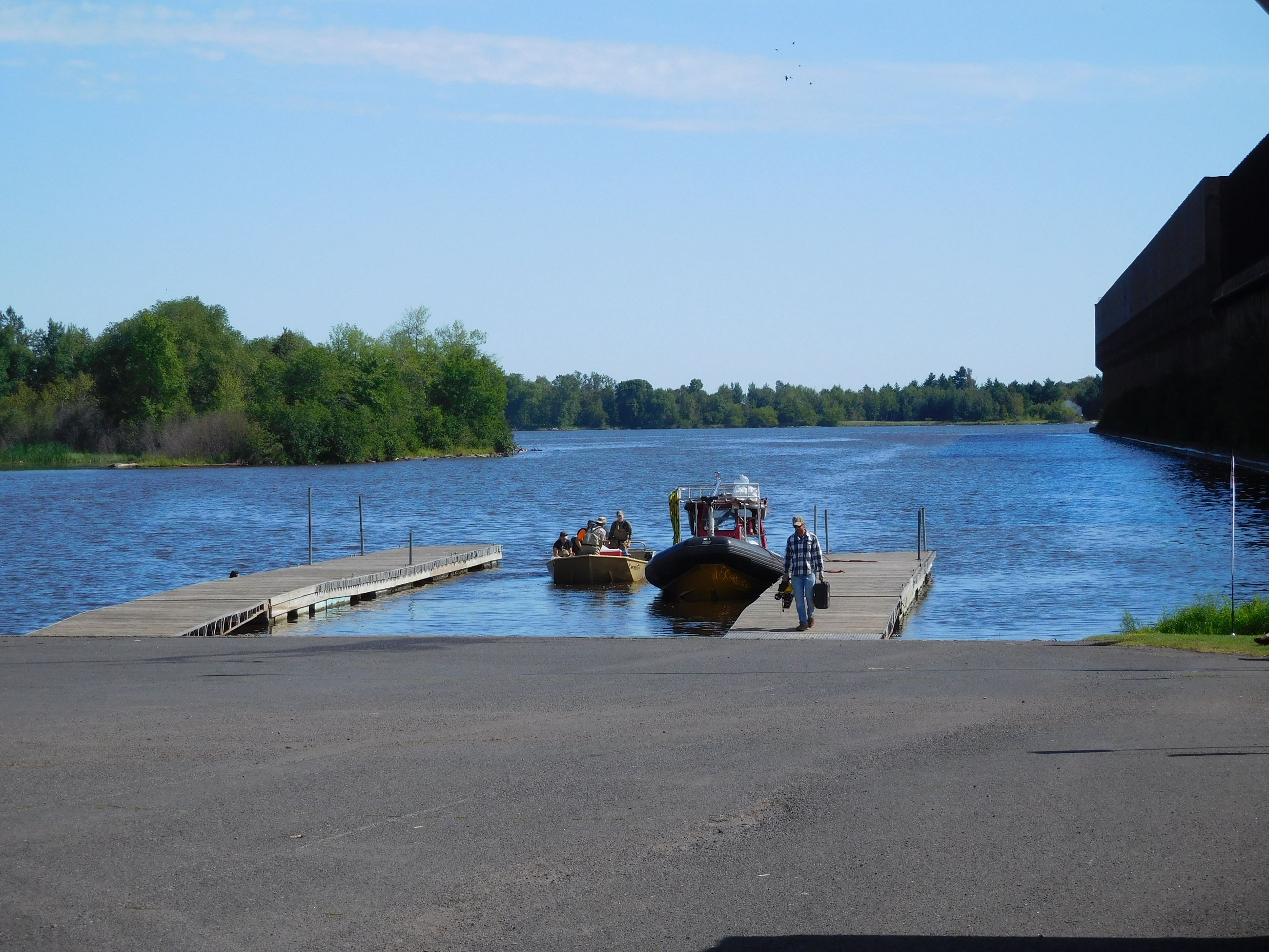 Loon's Foot Boat Launch - two docks and a boat with fisherman on dock